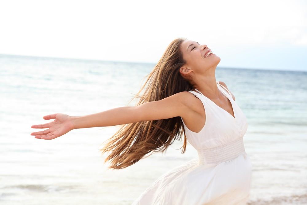Woman relaxing at beach enjoying summer freedom