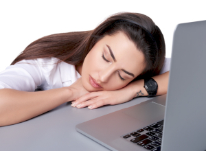 Businesswoman asleep on her laptop