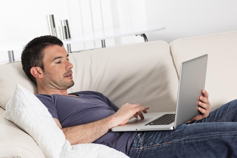 computer on sofa